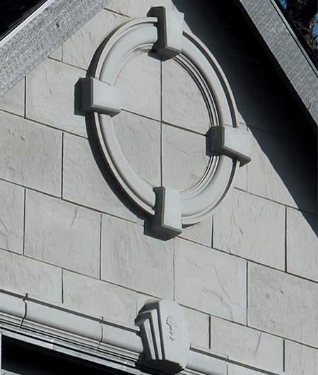 A circle pediment using Molding #1 (MLD1A2) and keystones (KEY97) to create the circle. Slate Tiles used to fill inside of the circle. Below keystone (KEY6) with curved edges and detail on the face.