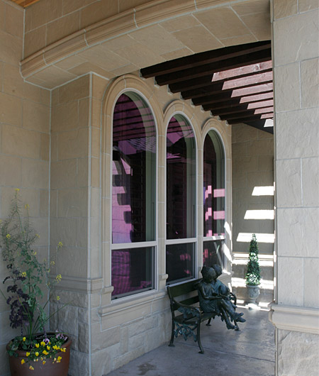 Random Chiseled Stone as wainscot with Molding #1 (MLD136) as wainscot cap and Slate Tiles above. Slate Tiles also used under arch. Molding #1 around window. Beautiful bronze statue, artist unknown.